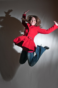 senior portrait, action, jumping, red coat