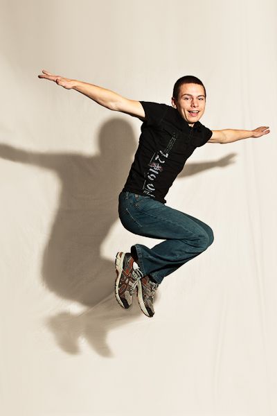 senior portrait, action, guy, jump, shadow